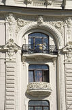 Latvia, Riga. Decorating a building balcony in the Stock Image