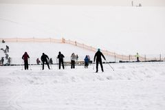 Latvia, Riga - February 17.2017: People winter sports skiin in the snow track route Royalty Free Stock Photo