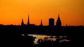 Latvia, Riga by night silhouette stock image