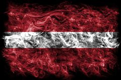 Latvia smoke flag on a black background Stock Image