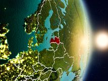 Latvia during sunrise. Highlighted in red on planet Earth with visible country borders. 3D illustration. Elements of this image furnished by NASA Stock Photo