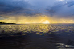 Latvia. Sunset on the river. Change in the weather. Elemental binge. During the transitional period, the spring, the strange sunsets happen on the river. There stock images