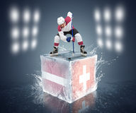 Latvia - Switzerland game. Face-off player on the ice cube. Royalty Free Stock Images