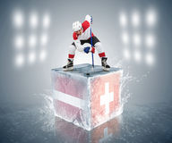 Latvia - Switzerland tournament game. Ready for Face-off player on the ice cube. Stock Images
