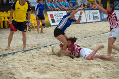 Latvia white vs Belarus blue. MOSCOW, RUSSIA - JULY 22-23, 2017: Rugby players in action at the  on European Beach Fives Rugby Championship 2017 in the match Royalty Free Stock Images