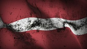 Latvia grunge dirty flag waving on wind. Latvian background fullscreen grease flag blowing on wind. Realistic filth fabric texture on windy day Royalty Free Stock Image