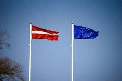 Latvian and European Union flags. Flying on the wind Stock Images