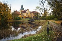 Latvian farmhouse with garden lake stock photography