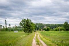Latvian farmhouse. Rural landscape. Royalty Free Stock Photography