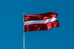 Free Latvian Flag Blowing In The Breeze. Royalty Free Stock Image - 92239316