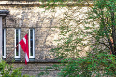 Latvian flag mourning those deported to Siberia in June. Royalty Free Stock Photography
