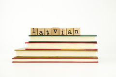 Latvian language word on wood stamps and books Royalty Free Stock Photo
