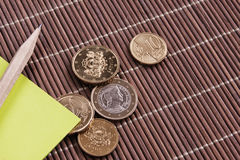 Latvian money. Coin paper pencil green brown straw Stock Photography