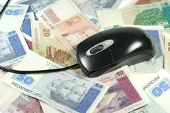 Latvian money and mouse. Latvian money and computer mouse symbolizing internet marketing Stock Photo