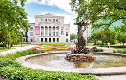 Latvian national opera and ballet theater with Nymph fountain. Royalty Free Stock Image