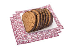 Latvian rye bread on the national tablecloths Stock Photos