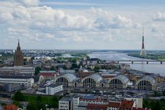 Latvian skyline with tower in background. Birds eye view of Latvian skyline with tower in background between long bridge and clear horizon Stock Photos