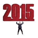 Latynoscy pracowników dźwignięcia liczba 2015 Zdjęcie Stock