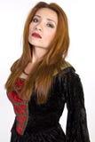 Latynoska kobieta jest ubranym kostiumową suknię Obraz Royalty Free