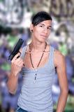 Latynoski mężczyzna z pistoletem obrazy royalty free