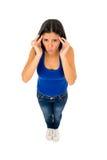 Latynoskiej kobiety wzruszający tempo z palcami cierpi migreny migrenę zdjęcie royalty free