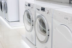 Laudry dryers and washing mashines in appliance Royalty Free Stock Photos