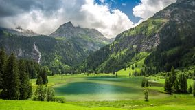 Lauenensee with waterfall and Swiss Alps in the background, Switzerland. stock video