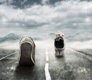 Laufen in den Regen Lizenzfreies Stockfoto