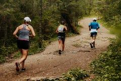 Laufen mit drei Läufern Stockfoto