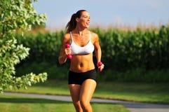 Laufen mit Gewichten Lizenzfreies Stockbild