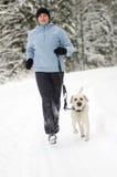 Laufen mit Hund Lizenzfreies Stockfoto
