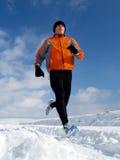 Laufen in Schnee Lizenzfreie Stockfotos