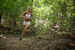 Laufen um die Biegung Stockbild