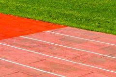 Laufende Bahn und Fußballplatz Lizenzfreies Stockfoto