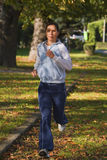 Laufende Frau Lizenzfreie Stockfotos