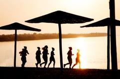 Laufende Frauenschattenbilder Lizenzfreie Stockbilder