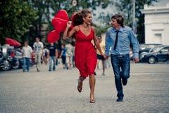 Laufende Jugendpaare Stockfotos