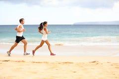 Laufende Leute - Frauen- und Mannathletenläufer Stockfoto