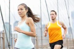 Laufende Paare Stockfoto