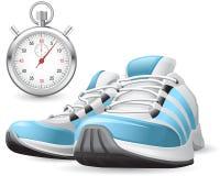 Laufende Schuhe und Stoppuhr Stockfoto