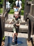 Laufender Junge auf Spielplatz 2 Lizenzfreie Stockbilder