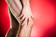 Laufender Körperschaden, Knieschmerz Stockfotos