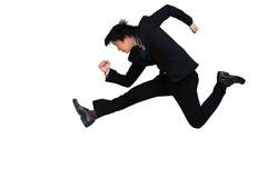 Laufender u. springender Geschäftsmann Stockfotografie