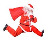Laufender Weihnachtsmann Lizenzfreie Stockbilder