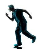 Laufendes Dringlichkeitschattenbild des Doktorchirurgmannes Lizenzfreie Stockfotos