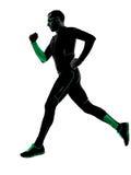 Laufendes rüttelndes Rüttlerschattenbild des Mannläufers Stockfotos