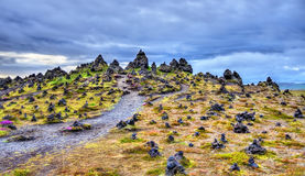 Laufscalavarda, a lava ridge, surrounded by stone cairns - Iceland Royalty Free Stock Image