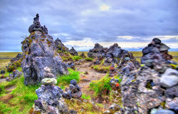 Laufscalavarda, a lava ridge, surrounded by stone cairns - Iceland Stock Photography