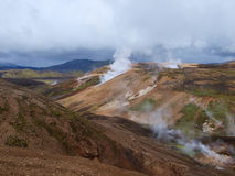 Laugavegur hike in Iceland. Rhyolite coloured hills and fumaroles seen from the trail Stock Image