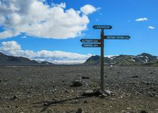Laugavegur hiking trail marker sign post with directions to Emstrur-Botnar, Alftavatn, Hvanngil, Highlands of Iceland. Laugavegur hiking trail marker post with royalty free stock photography
